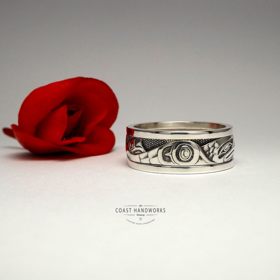 Hand made, hand carved native art wedding band in white gold depicting a Haida-style eagle