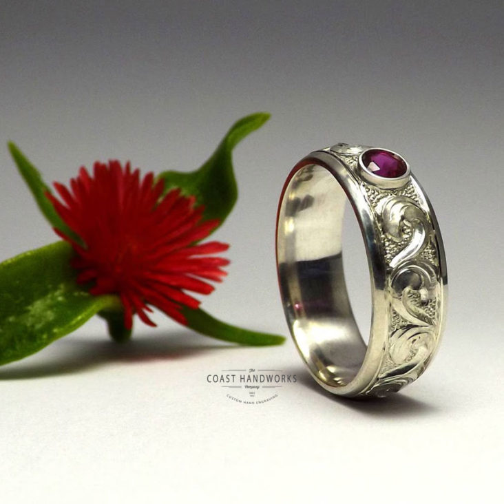 Unique, timeless baroque scroll hand carved in silver, gold or white gold with a bezelled setting for your choice of gemstone, including genuine and synthetic gems