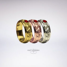 Traditional, hand carved baroque scroll available in yellow, white and rose gold, set with gemstone in bezel