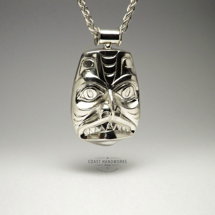 White Gold Pendant with traditional depiction of Dogfish carved in the Haida-style of Northwest Coast Native Art