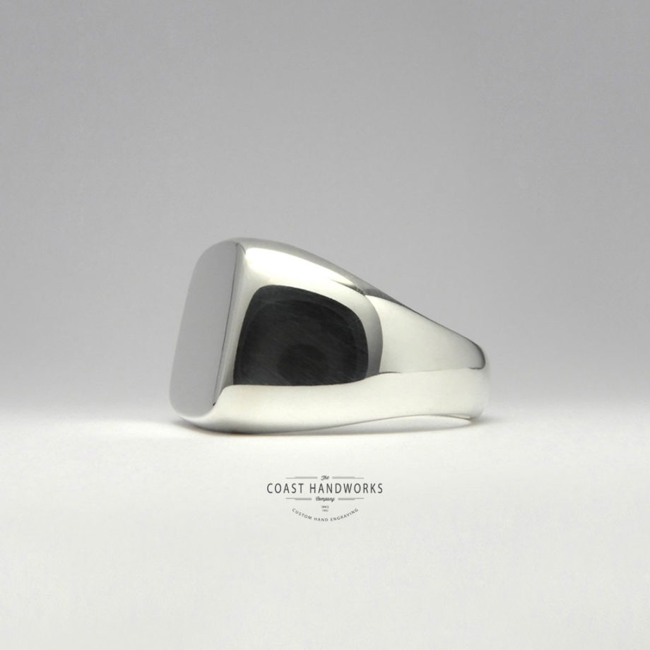 White gold signet ring with wide shanks gently tapering to slim fit at the bottom - a popular grad ring!
