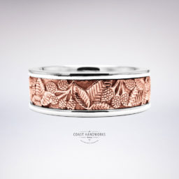 Original blackberry artwork carved in relief on a rose gold center, left in its natural state (clean) then framed with white gold rails